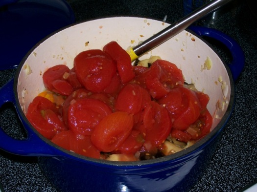 The tomatoes are added to the eggplant and peppers