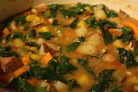Fall vegetable soup simmering on the stove