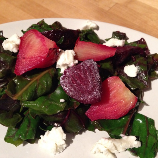 Warm beet greens salad with roasted beets and goat cheese